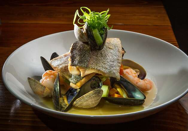 Fillets of crisped Idaho red trout are stacked atop clams, mussels and shrimp at the Corner Store. Photo: John Storey, Special To The Chronicle