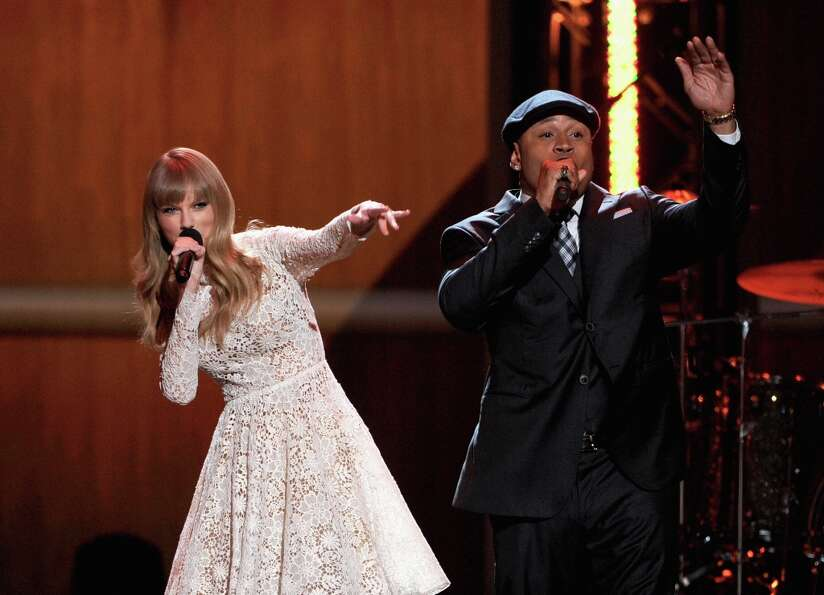Singer Taylor Swift (L) and rapper LL Cool J perform onstage at The GRAMMY Nominations Concert Live!