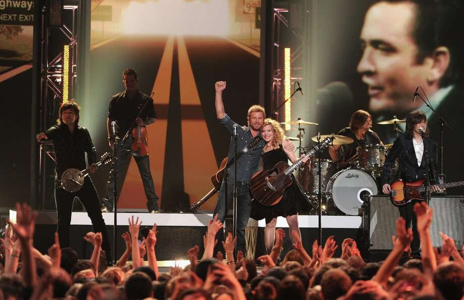 Dierks Bentley (center) and Neil Perry, Kimberly Perry, and Reid Perry of The Band Perry onstage at