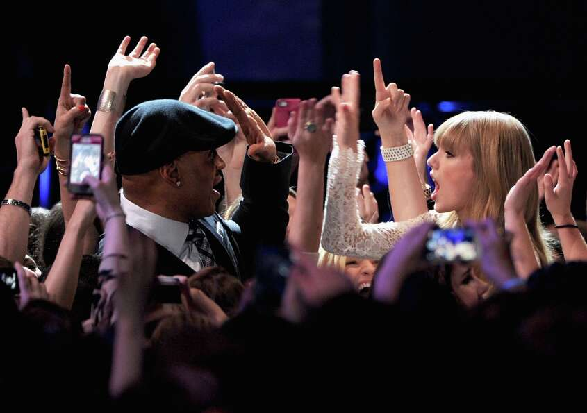 LL Cool J and Taylor Swift onstage at The GRAMMY Nominations Concert Live!! held at Bridgestone Aren