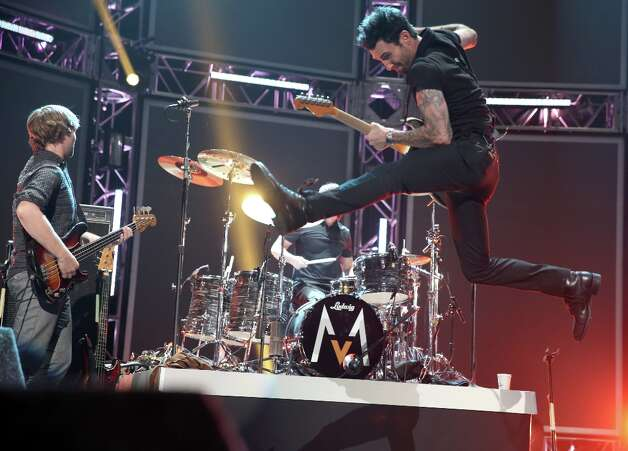(L-R) Musicians Mickey Madden, Matt Flynn and Adam Levine of Maroon 5 perform onstage at The GRAMMY Nominations Concert Live!! held at Bridgestone Arena on December 5, 2012 in Nashville, Tennessee.  (Photo by Christopher Polk/Getty Images) Photo: Christopher Polk, Getty Images / 2012 Getty Images
