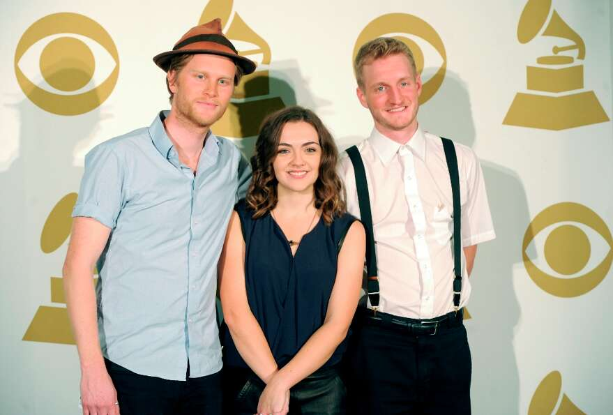 (L-R) Musicians Wesley Schultz, Neyla Pekarek and Jeremiah Fraites of The Lumineers pose in the pres