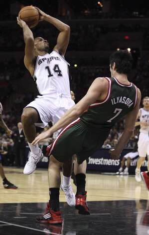 San Antonio Spurs' Gary Neal goes for two against Milwaukee Bucks' Ersan Ilyasova during the second half at the AT&T Center, Wednesday, Nov. 5, 2012. The Spurs won 110-99. Neal ended the game with 22 points. (Jerry Lara / San Antonio Express-News)