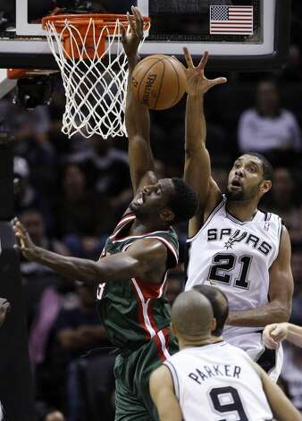 San Antonio Spurs' Tim Duncan tries to block Milwaukee Bucks' Ekpe Udoh during the second half at the AT&T Center, Wednesday, Nov. 5, 2012. The Spurs won 110-99. (Jerry Lara / San Antonio Express-News)