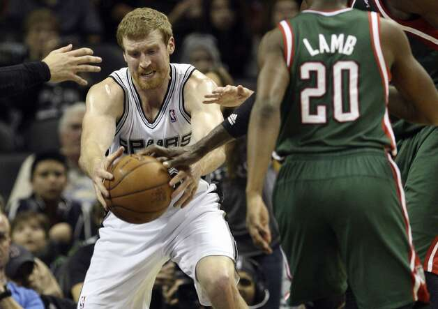 San Antonio Spurs' Matt Bonner grabs a rebound during the second half against the Milwaukee Bucks at the AT&T Center, Wednesday, Nov. 5, 2012. The Spurs won 110-99. Bonner ended with a game high of 12 rebounds. (Jerry Lara / San Antonio Express-News)