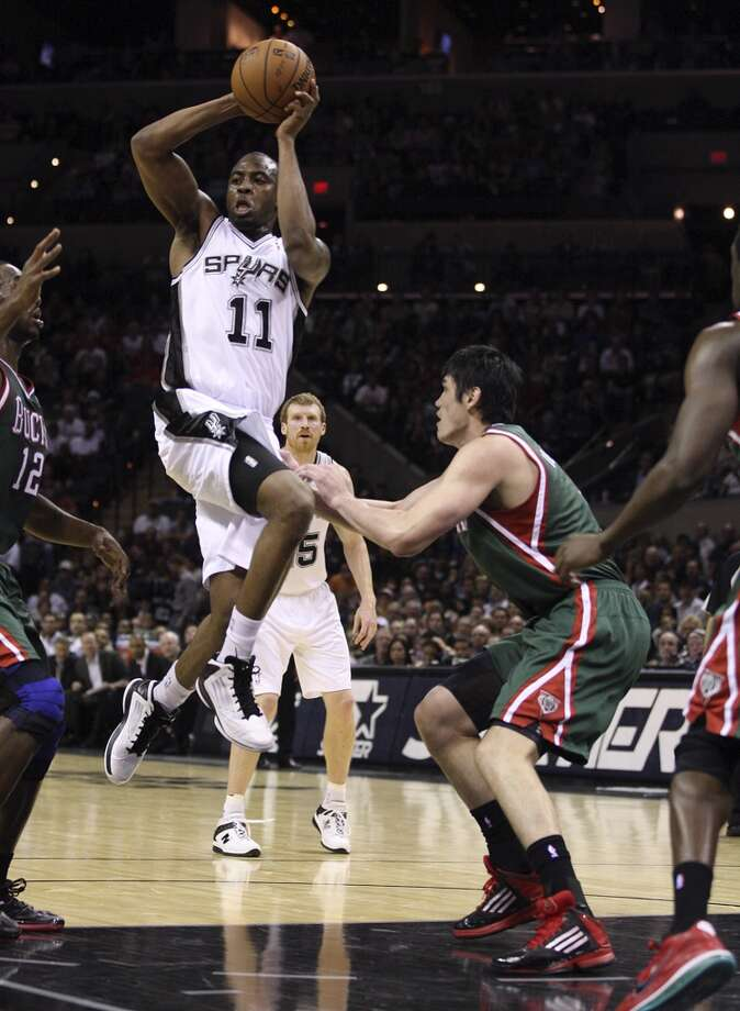 San Antonio Spurs' James Anderson passes out to the perimeter during the second half against the Milwaukee Bucks' at the AT&T Center, Wednesday, Nov. 5, 2012. The Spurs won 110-99. (Jerry Lara / San Antonio Express-News)