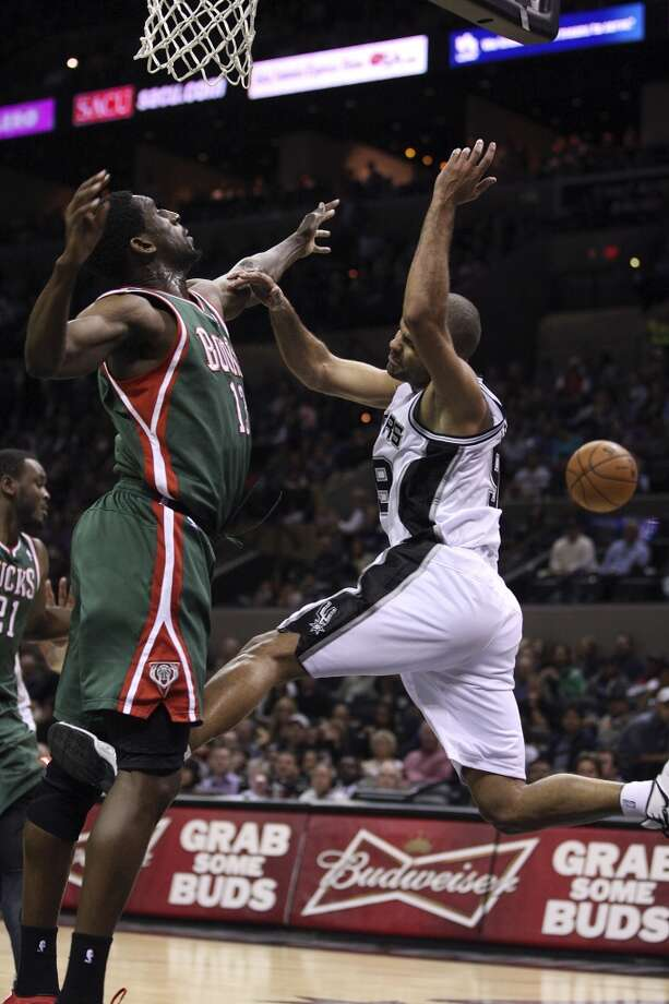 San Antonio Spurs' Tony Parker attempts to draw a foul from Milwaukee Bucks' Ekpe Udoh during the second half at the AT&T Center, Wednesday, Nov. 5, 2012. The Spurs won 110-99. (Jerry Lara / San Antonio Express-News)