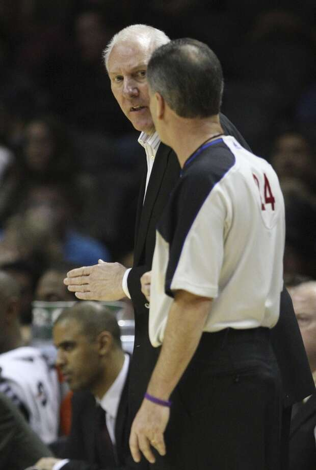 San Antonio Spurs' Head Coach Gregg Popovich discusses a foul with official Mike Callahan in the second half against the Milwaukee Bucks at the AT&T Center, Wednesday, Nov. 5, 2012. The Spurs won 110-99. (Jerry Lara / San Antonio Express-News)
