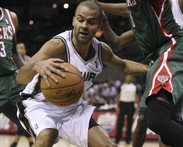 San Antonio Spurs' Tony Parker keeps the ball away from Milwaukee Bucks' Larry Sanders during the second half at the AT&T Center, Wednesday, Nov. 5, 2012. The Spurs won 110-99. (Jerry Lara / San Antonio Express-News)
