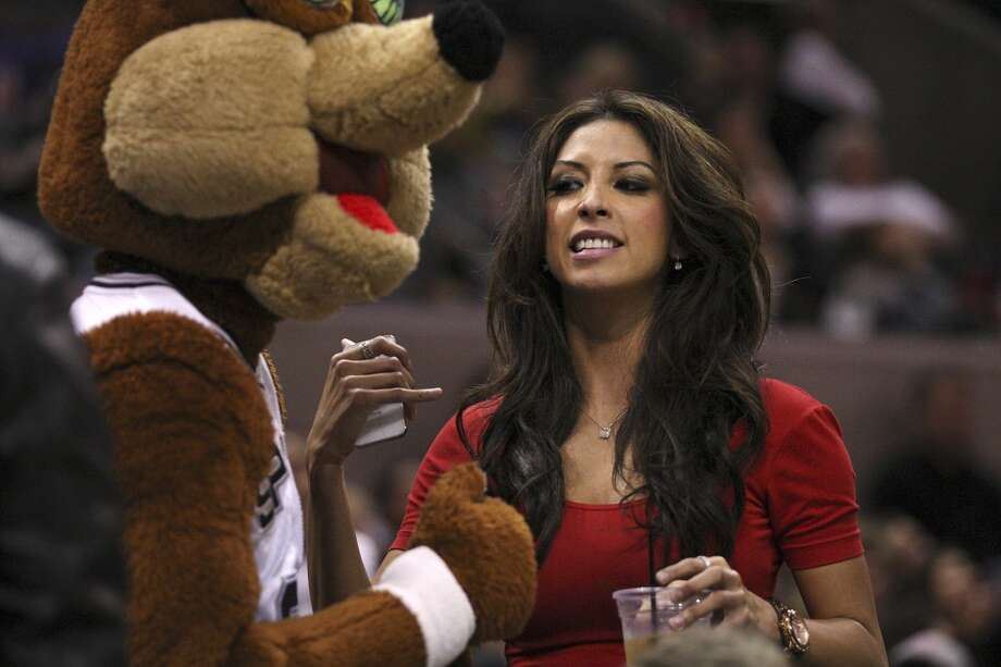 San Antonio celebrity Vanessa Macias chats with the Coyote during the San Antonio Spurs/Milwaukee Bucks game at the AT&T Center, Wednesday, Nov. 5, 2012. The Spurs won 110-99. (Jerry Lara / San Antonio Express-News)