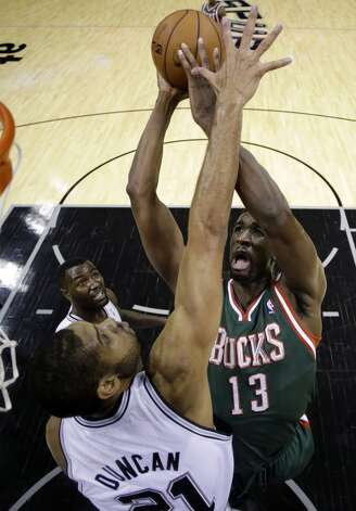 Milwaukee Bucks' Ekpe Udoh (13) shoots over San Antonio Spurs defender Tim Duncan, left, during the first quarter of an NBA basketball game on Wednesday, Dec. 5, 2012, in San Antonio. San Antonio won 110-99. (Eric Gay / Associated Press)