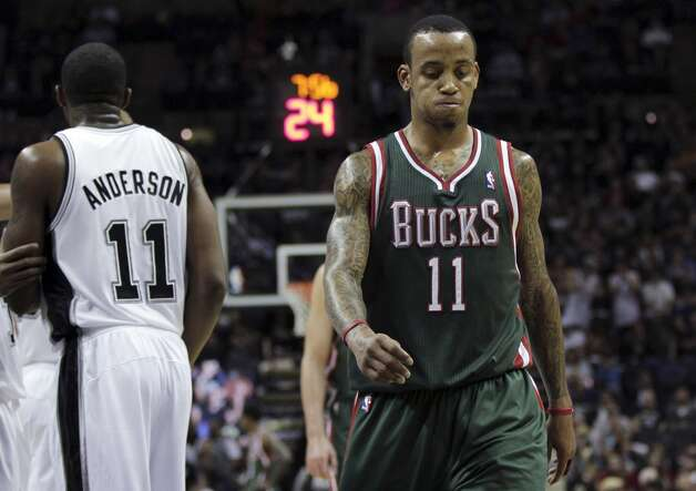 Milwaukee Bucks' Monta Ellis, right, walks downcourt during the fourth quarter of an NBA basketball game against the San Antonio Spurs, Wednesday, Dec. 5, 2012, in San Antonio. San Antonio won 110-99.  (Eric Gay / Associated Press)