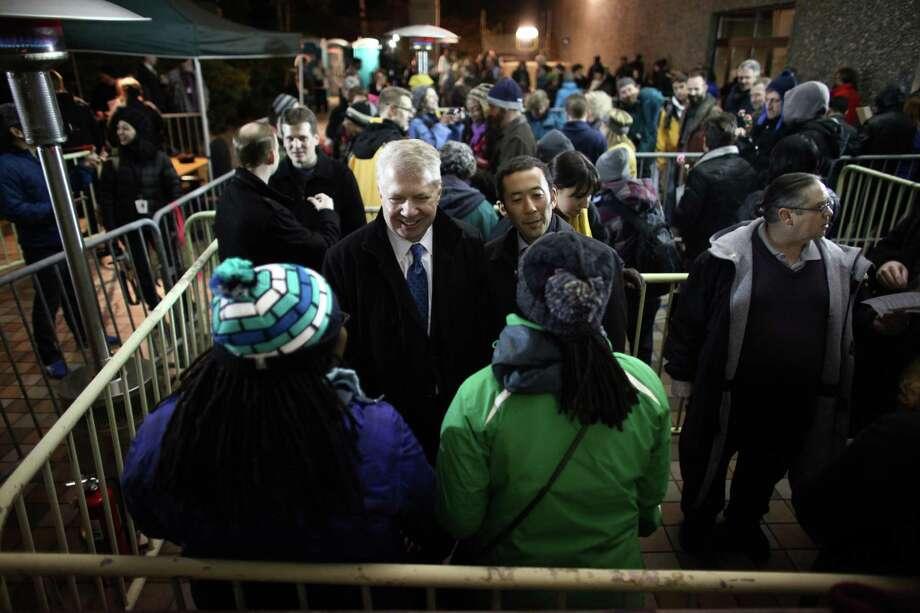 Washington State Senator Ed Murray speaks to same-sex couples as they wait in line.  Photo: JOSHUA TRUJILLO / SEATTLEPI.COM