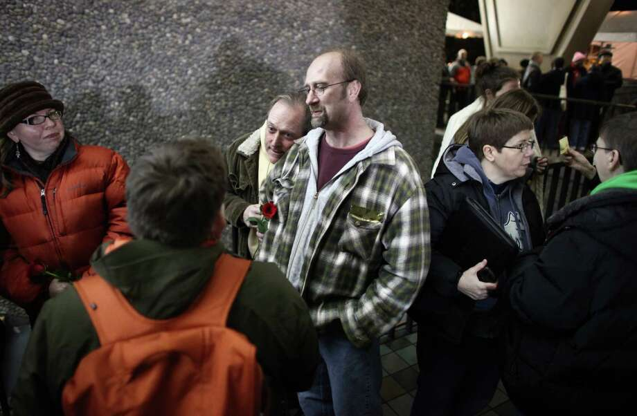 Couples wait in line outside of the King County Administration Building. Photo: JOSHUA TRUJILLO / SEATTLEPI.COM