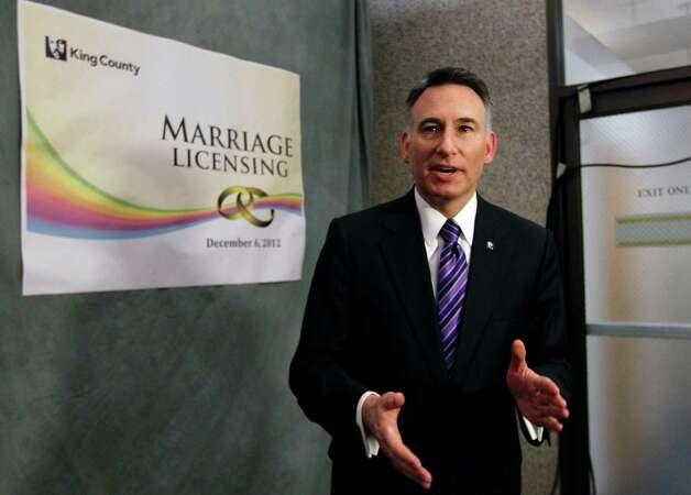 King County Executive Dow Constantine speaks to reporters on Wednesday, Dec. 5, 2012, about issuing marriage licenses to same-sex couples just after midnight in Seattle. Constantine began issuing the licenses immediately upon certification of the November election that passed Referendum 74. Photo: AP