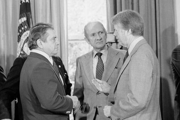 President  Jimmy Carter chats with Reps. Dante Fancell, R-Fla., left, and Jack Brooks, D-Texas at the White House on Wednesday, April 7, 1977 in Washington after signing legislation which gives him authority to make changes in the federal government's structure.   Carter said that his administration is determined to recognize and streamline the executive branch of our government. Photo: Harvey Georges, Associated Press / AP1977