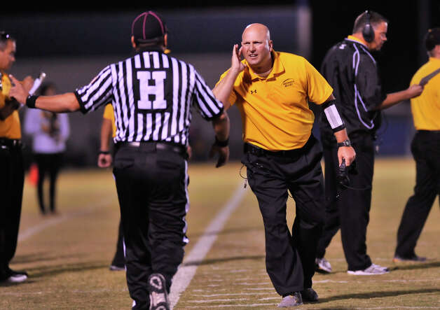 Brennen coach Stephen Basore tries to listen to an officials explanation. October 19, 2012 Photo: Robin Jerstad, San Antonio Express-News