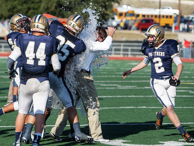 O'Connor head coach David Malesky gets a gatorade shower following the Panthers' 34-28 victory over Judson in their Class 5A Division II second round playoff game at Comalander Stadium on Nov. 24, 2012.  MARVIN PFEIFFER/ mpfeiffer@express-news.net Photo: MARVIN PFEIFFER, San Antonio Express-News / Express-News 2012