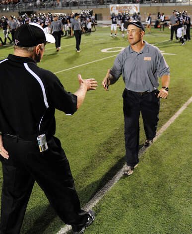 Brandeis head football coach John Campbell (right) shakes hands with Stevens head football coach Lee Bridges after a District 28-5A football game between the Stevens Falcons and Brandeis Broncos at Farris Stadium in San Antonio, Texas on September 17, 2010  John Albright / Special to the Express-News. Photo: JOHN ALBRIGHT, San Antonio Express-News / San Antonio Express-News