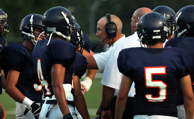 Brandeis Football Coach John Campbell talks to his team during a timeout during their opening game against the Johnson Jaguars, Saturday, Aug. 30, 2008 at Farris Stadium. BOB OWEN/rowen@express-news.net Photo: Bob Owen, San Antonio Express-News / rowen@express-news.net