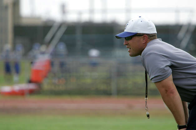Coach John Campbell watches the Jay High School football team during practice at the school in San Antonio on Aug. 14, 2006. Photo: LISA KRANTZ, San Antonio Express-News / © San Antonio Express-News