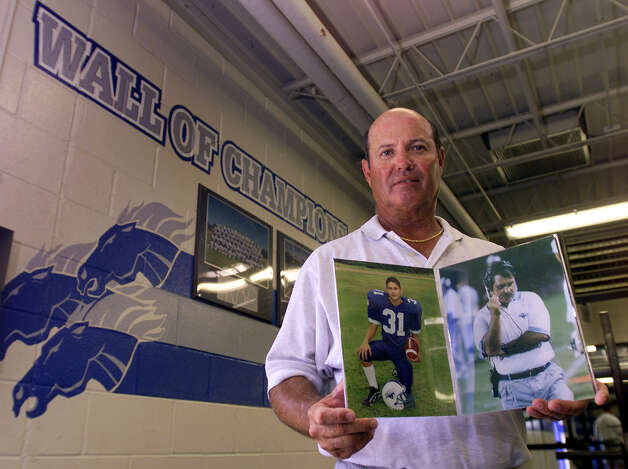 "Jay High School head coach Larry Pullin holds photos of close friend and assistant Bob Johns (right) and former football player Jaime Castoreno. Pullin still copes with the deaths of Johns and Castoreno. In memoriam, Pullin will take the photos with him to football games and will eventually place their photos on the school's ""Wall of Champions"". Kin Man Hui/staff. Photo: Kin Man Hui, San Antonio Express-News / SAN ANTONIO EXPRESS-NEWS"