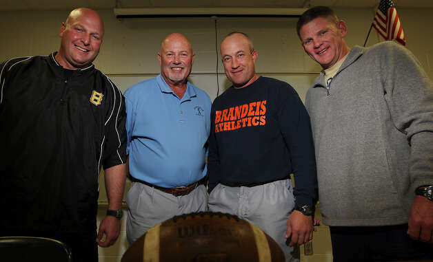 Former Jay High School football coach (second from left) has the distinction of having three former assistant coaches who are now head coaches in their own right and are leading their high school teams into the 2012 playoffs. The coaches are: Brennan High coach Stephen Basore (from left), Brandeis High coach John Campbell and O'Connor High coach David Malesky. Photo: Kin Man Hui, San Antonio Express-News / ©2012 San Antonio Express-News