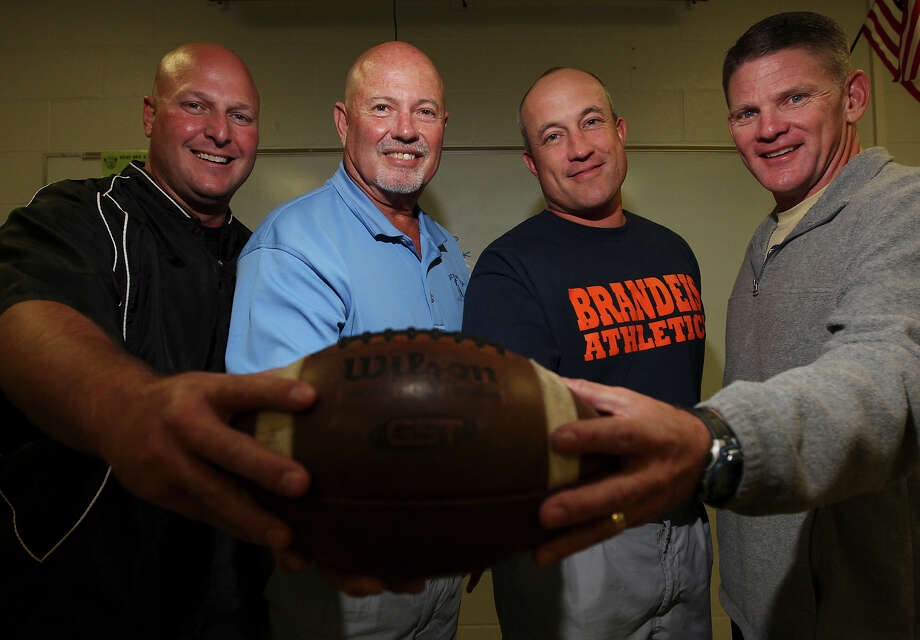 Former Jay High School football coach Larry Pullin (second from left) has three former assistants who have led their new teams to this weekend's state quarterfinals: Brennan coach Stephen Basore (far left), Brandeis coach John Campbell (third from left) and O'Connor's David Malesky. Photo: Kin Man Hui, San Antonio Express-News / ©2012 San Antonio Express-News
