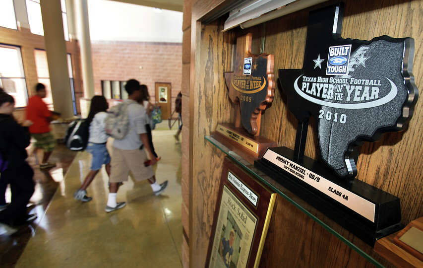 Tivy High School students walk past the trophy case containing some of Johnny Manziel's awards, i
