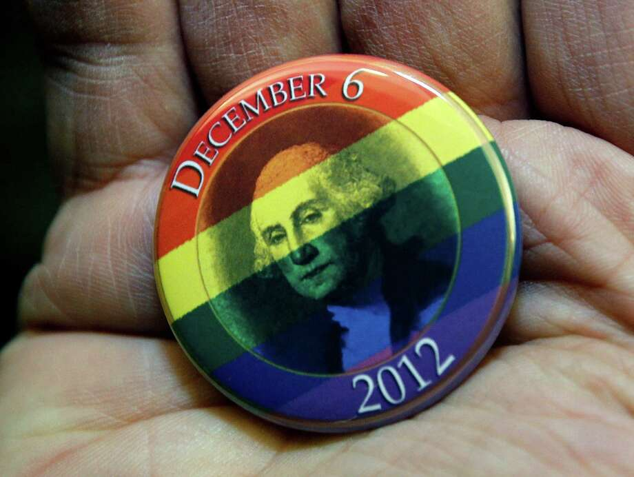 A button celebrating the issuing of marriage licenses to same-sex couples is displayed. Photo: AP