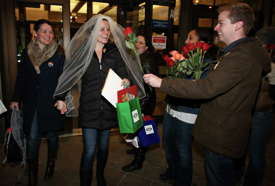 Jeri Andrews, left, and her partner of five years Amy Andrews walk out of the King County Administration Building with their marriage license on Thursday, December 6, 2012. Photo: JOSHUA TRUJILLO / SEATTLEPI.COM