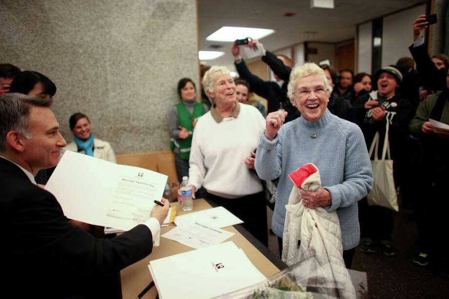 Jane Abbott Lightly and her partner Pete-e Petersen, right, celebrate as King County Executive Dow Constantine signs their marriage license at the King County Administration Building on shortly after midnight on Thursday, December 6, 2012. Photo: JOSHUA TRUJILLO / SEATTLEPI.COM
