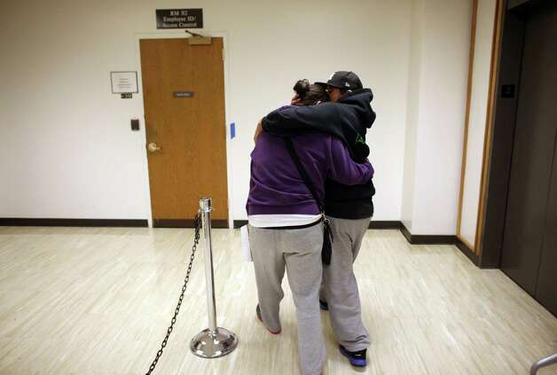 Kelly Middleton, 24, and her partner Amanda Dollente, 29, embrace after they received their marriage license at the King County Administration Building on Thursday, December 6, 2012. Photo: JOSHUA TRUJILLO / SEATTLEPI.COM
