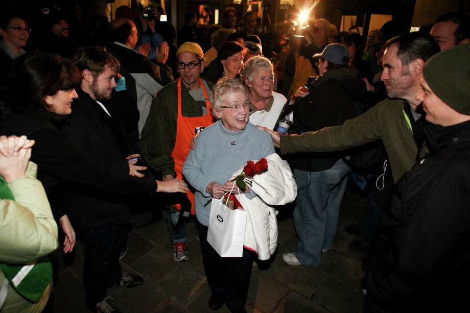 Jane Abbott Lightly and her partner Pete-e Petersen are greeted by well-wishers outside the King County Administration Building. Photo: JOSHUA TRUJILLO / SEATTLEPI.COM