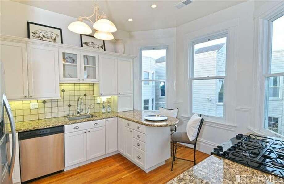 Smallish kitchen. Photos via Estately/TRI Coldwell Banker