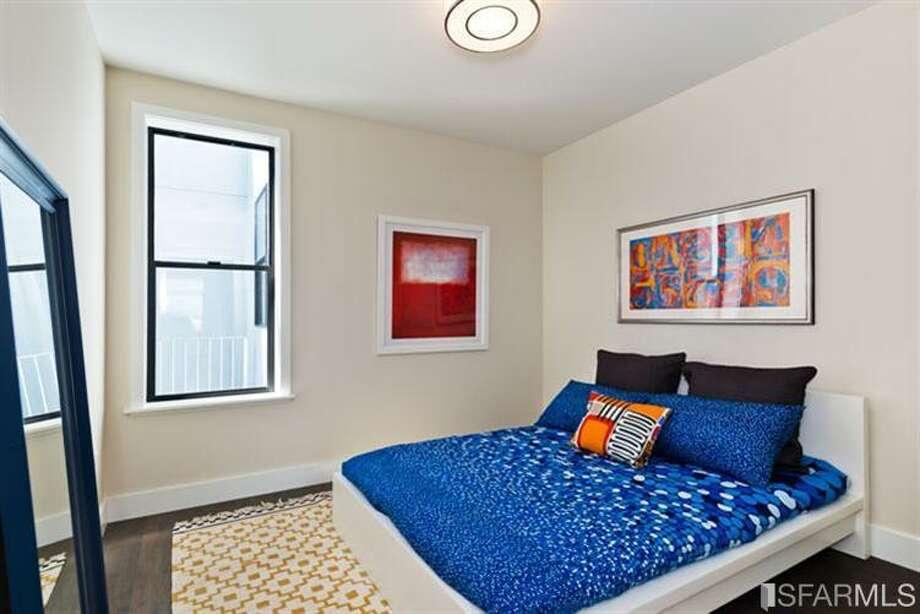2nd bedroom. Photos via Estately/Van Guard Properties