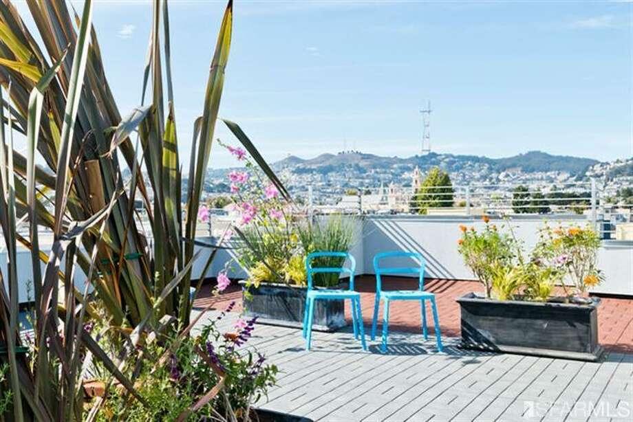 Roof deck! Photos via Estately/Van Guard Properties