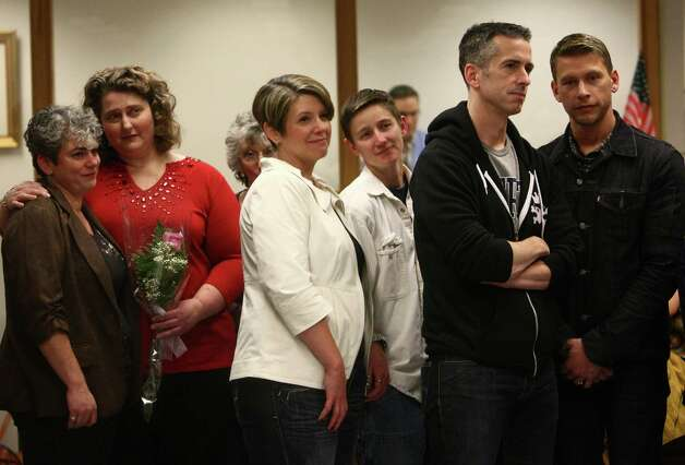 Couples, including columnist Dan Savage and his partner Terry Miller, right, wait in line for their marriage licenses at the King County Administration Building on Thursday, December 6, 2012. Savage is a prominent gay rights activist. Photo: JOSHUA TRUJILLO / SEATTLEPI.COM