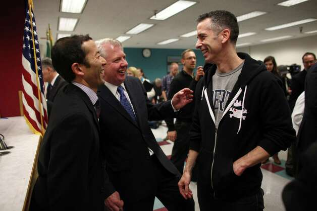 Michael Shiosaki, Senator Ed Murray and columnist Dan Savage share a laugh after Savage was issued a marriage license at the King County Administration Building on Thursday, December 6, 2012. Photo: JOSHUA TRUJILLO / SEATTLEPI.COM