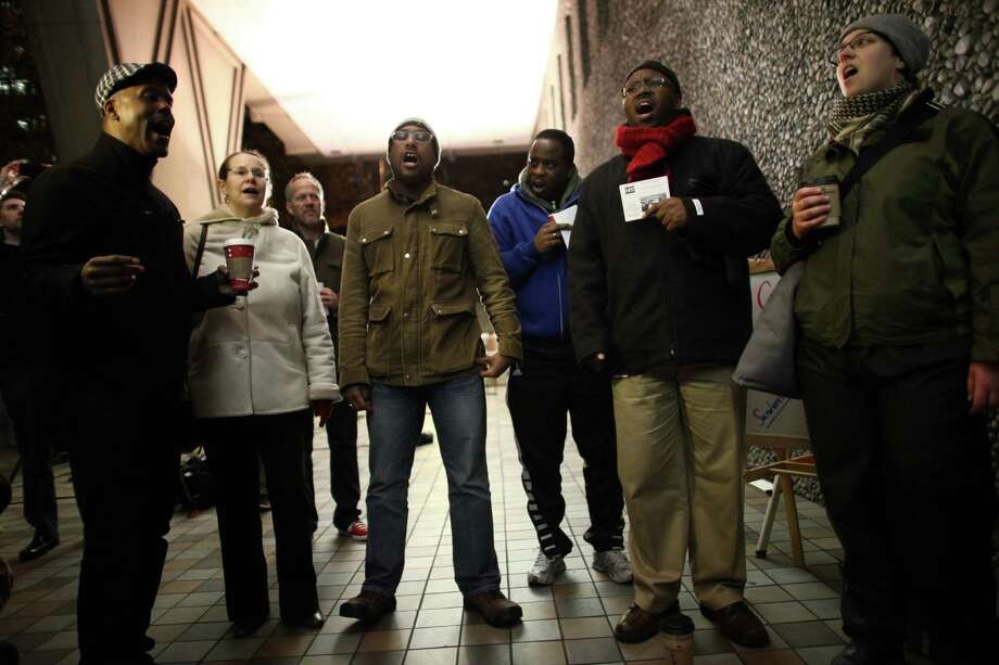 The choir from the Madrona Liberation United Church of Christ performs as gay couples wait in line for marriage licenses. Photo: JOSHUA TRUJILLO / SEATTLEPI.COM