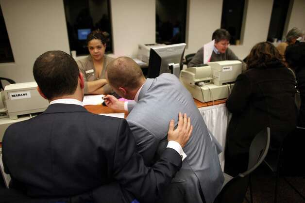 Justin Goodman, left, fills out marriage paperwork with his partner Jake Bartholomy at the King County Administration Building on Thursday, December 6, 2012. Photo: JOSHUA TRUJILLO / SEATTLEPI.COM
