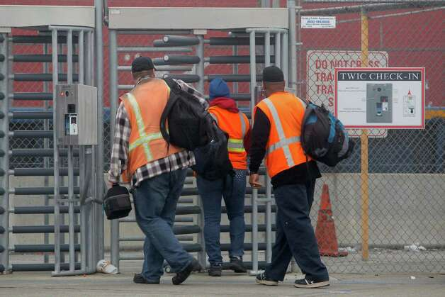 Port workers return to work at the Port of Long Beach Wednesday, Dec. 5,  2012. Work resumed at the Los Angeles and Long Beach harbors after settlement of a strike that crippled the nation's busiest container port complex for more than a week. (AP Photo/Nick Ut) Photo: Nick Ut