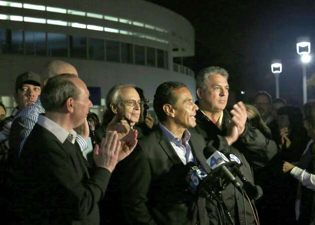 Mayor Antonio Villaraigosa announces the end of the week old Ports of Los Angeles and Port of Long Beach strikes during a news conference Tuesday night Dec 4, 2012 in Wilmington, Calif. Clerical workers and longshoremen at the nation's largest port complex will return to work Wednesday, eight days after they walked out in a crippling strike that prevented shippers from delivering billions of dollars in cargo across the country. (AP Photo/Chuck Bennett, Daily Breeze) Photo: Chuck Bennett