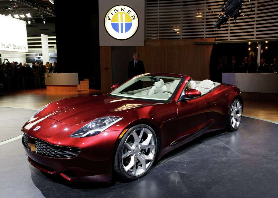 Fisker Karma: The Fisker Karma had a rough year in 2012 after two of the luxury cars, including one in the Houston area, caught fire and burned to the ground. The automaker also had to suspend operations after running out of batteries. Photo: Paul Sancya / AP