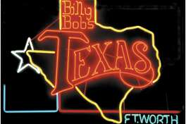 Billy Bob's Texas :  Dallas might have its skyscrapers, but Fort Worth has the world's largest honky tonk. While dozens of well known musicians have performed there, it's property value might surprise you. 