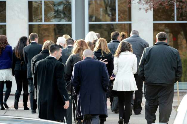 Family members arrive at the St. Edward the Confessor Church in Clifton Park, N.Y. Dec 6, 2012 for the funeral of accident victim Deanna Rivers.  (Skip Dickstein/Times Union) Photo: SKIP DICKSTEIN / 00020374A