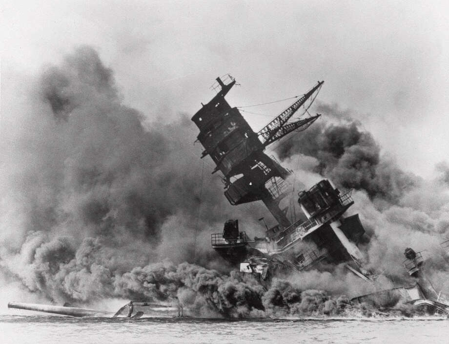 In this Dec. 7, 1941 file photo, the battleship USS Arizona belches smoke as it topples over into the sea during a Japanese surprise attack on Pearl Harbor, Hawaii. Wednesday is the 70th anniversary of the attack that brought the United States into World War II. Photo: Anonymous, Associated Press / 1942 AP