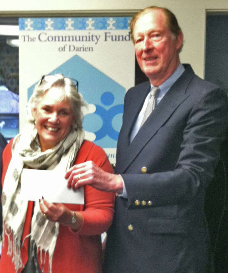 Ceci Maher, executive director of Person-to-Person, accepts a check from Ray Hodil, vice president of allocations for The Community Fund of Darien. Photo: Contributed Photo