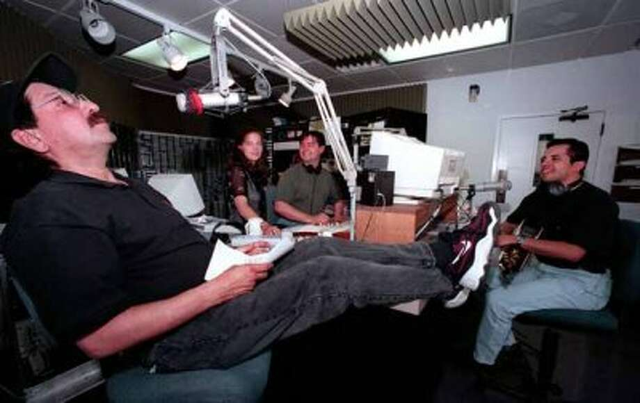 Kelley Kendall, John Lisle and Steve Hahn in studio at KISS-FM in 1999. Jorge Gallegos was the Contestant on the day's Uncle Johnny's Meet Market. Photo: Charles Barksdale