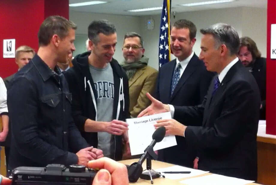 Author and columnist Dan Savage and his husband, Terry Miller, were among the first same-sex couples to receive a Washington marriage license on Thursday, Dec. 6, 2012. The couple, who started the It Gets Better Project to help prevent suicide along LGBT youth, married in Canada in 2005. (Casey McNerthney/seattlepi.com)